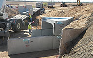 Extending existing cast-in-place channel with precast reinforced concrete box culvert on I-10 in Pinal County, Arizona for the Arizona Department of Transportation (ADOT) using a double-cell 10' wide x 7' High Type II box culvert with skewed-end sections to match existing channel alignment.